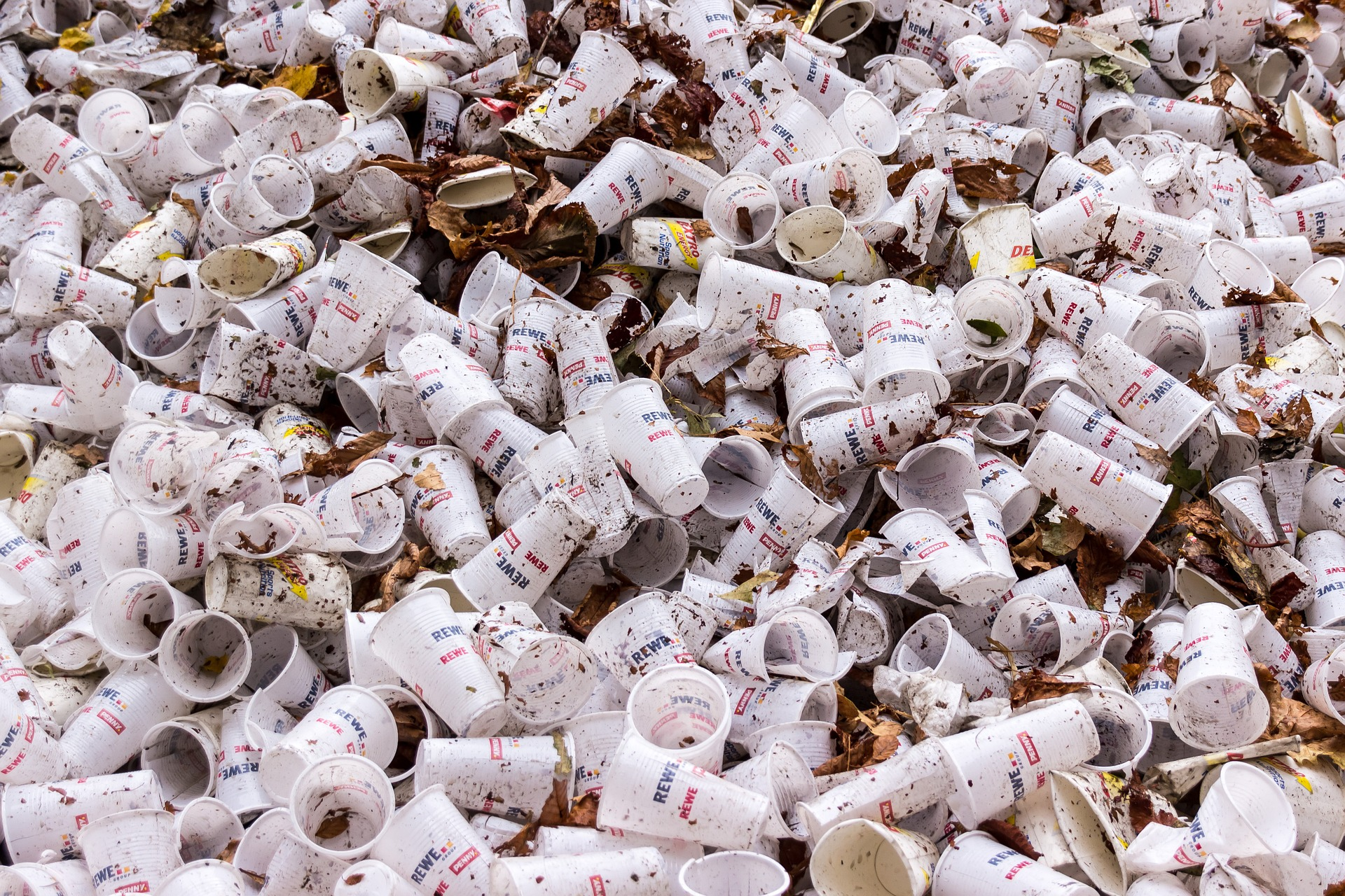A pile of plastic cups in landfill