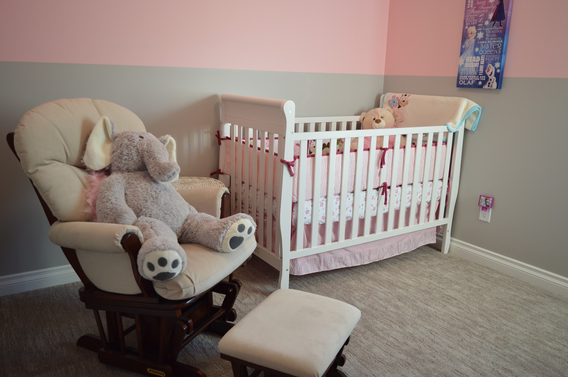 A nursing chair and a baby's cot in a nursery