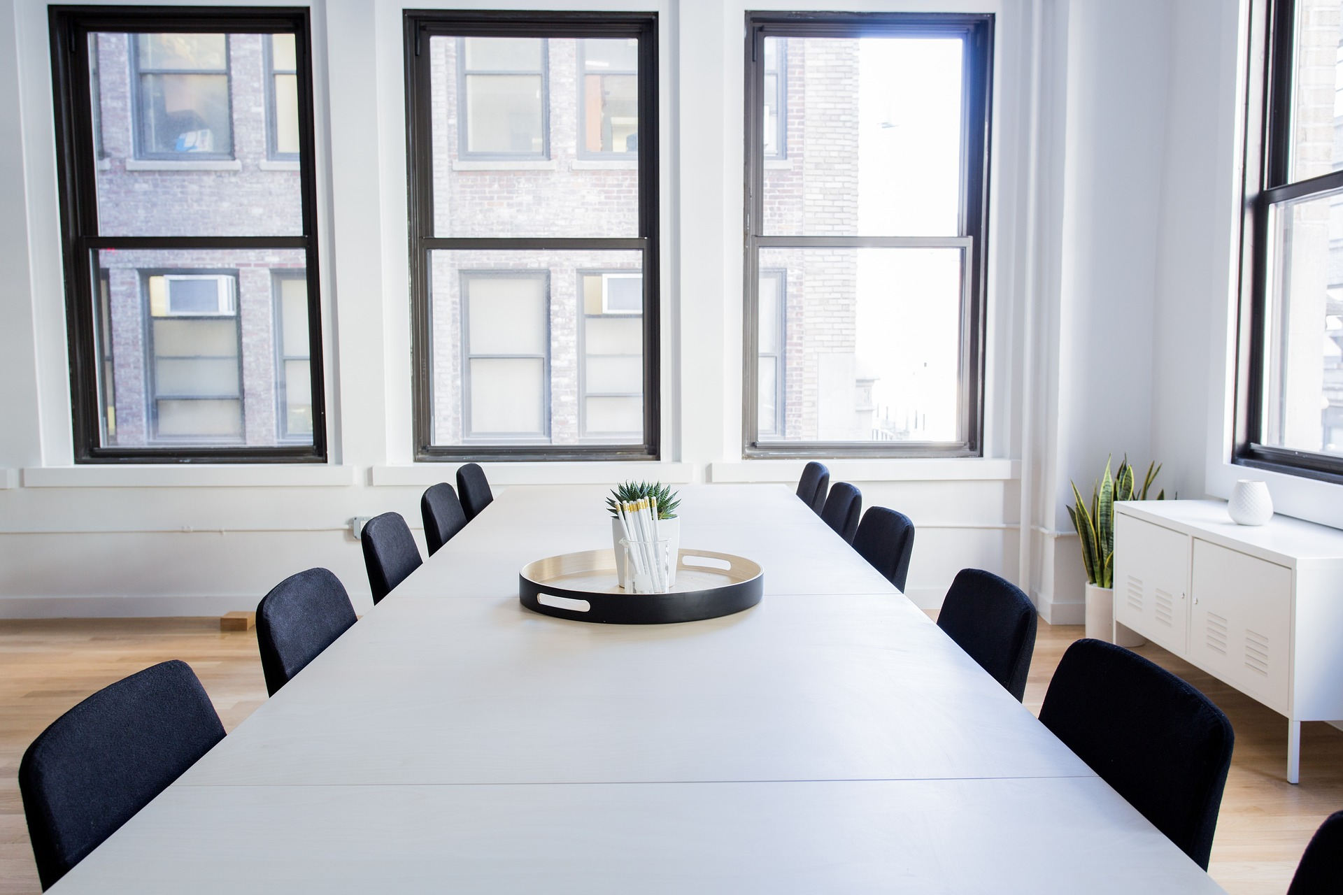 A conference room with empty chairs around a meeting table