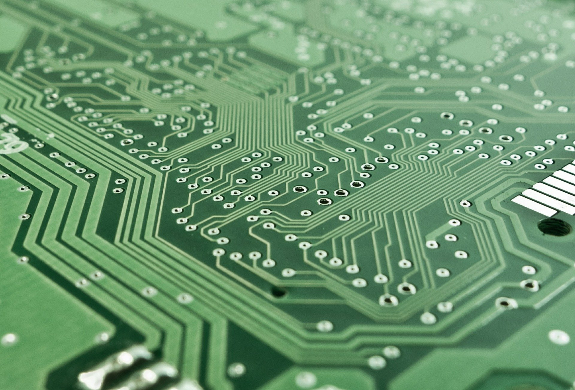 A close-up image of a green electric circuit board
