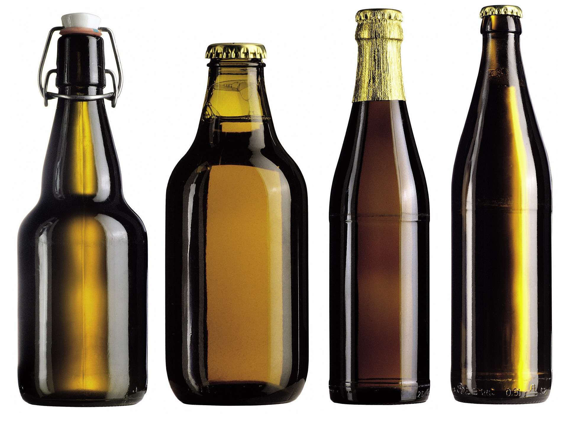 four beer bottles without labels